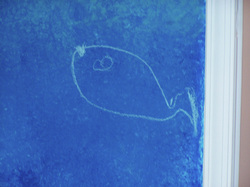 Gabriel (age 2) drew this fish in chalk on his wall while I was drawing his life sized orca...